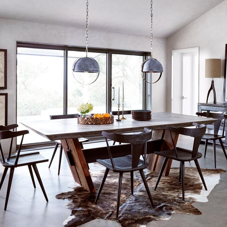 The Bonham Dining Table is alternative take on an environmentally friendly design. A concrete top rests over two legs constructed of reclaimed and recycled hard woods and is all tied together by an ir