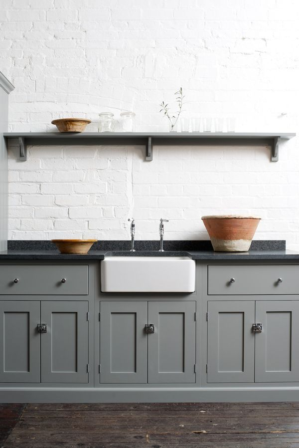 This appeals to me too. The grey darker cabinets and counters offset by the white brick and sink.