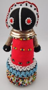 Fertility Dolls handmade in South Africa. Fertility is of major importance to the Ndebele people. A fertility doll is made (in secret) for the bride by the maternal grandmother and is ritually presented to her when she enters her new hut after the wedding ceremony.  www.threemadfish.com