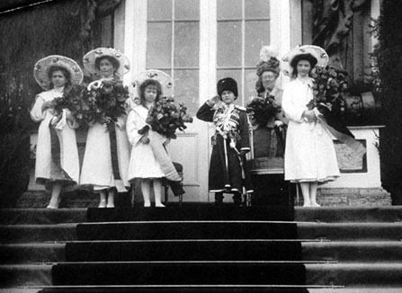The Romanov children at what appears to be some sort of official event. Alexei looks quite spiffy in his Cossack uniform.