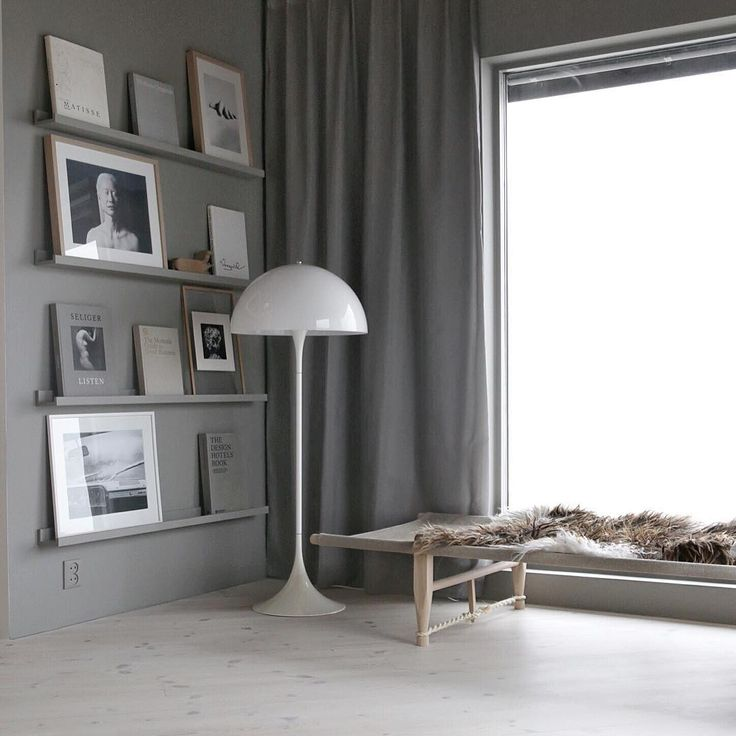 Grey on grey #livingroom #stylizimohouse #fiftyshadesofgrey #daybed #curtains #picturewall #bookwall