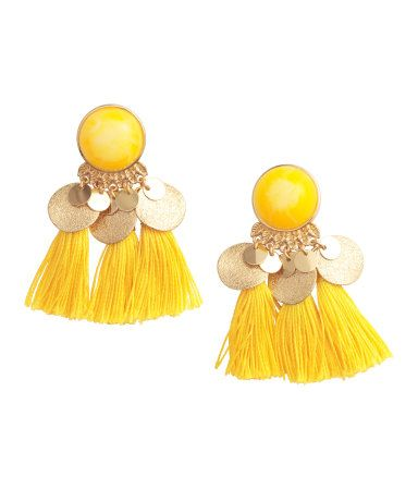 Yellow. Earrings with a plastic bead, round metal pendants, and decorative tassels. Length 2 1/2 in.