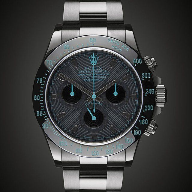 A customized Rolex Daytona Avatar by Titan Black. 40mm Black DLC Case. Avatar Dial with Dark Grey Markers. Automatic Chronograph Movement. Sapphire Crystal Glass. Water Resistance 100/330ft. Flip Lock Bracelet. Please allow 3-4 weeks for shipping.