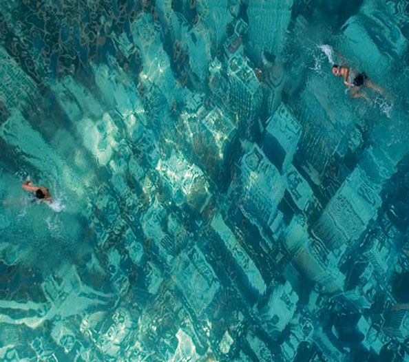 A Pool Painted to Look Like Your Swimming Atop a Flooded City of SkyScrapers and Tower Blocks | Amazing Pools | Pinterest | Places, Swimming and Swimming pools