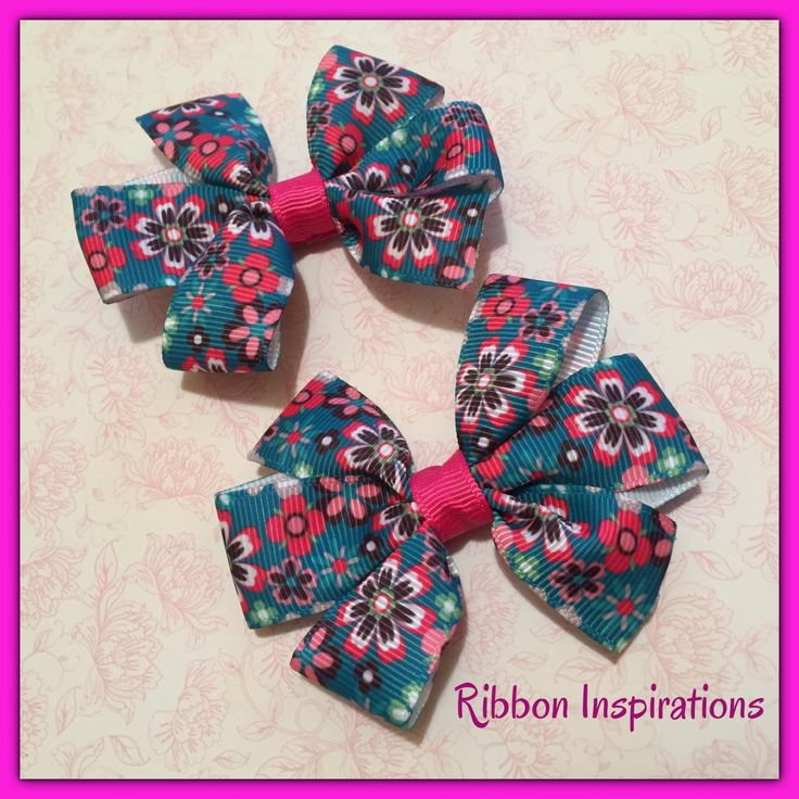 Pair of cute pinwheel bows on double prong lined alligator clips. These have non slip grip to help the bows stay in the hair.