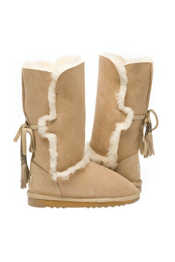 Great long fashion boot which has fur sheepskin trimmings on the both sides of boot. Also has 2 long tassles that sit on the back to complement Ugg boot.