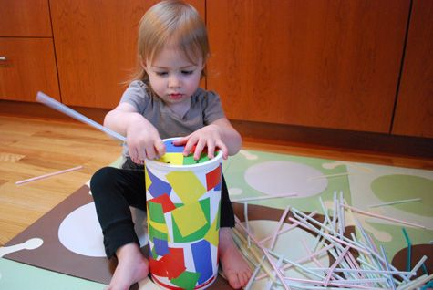 The 'straw game'. An empty oatmeal container and a package of multicolored straws becomes an entertaining and educational activity.
