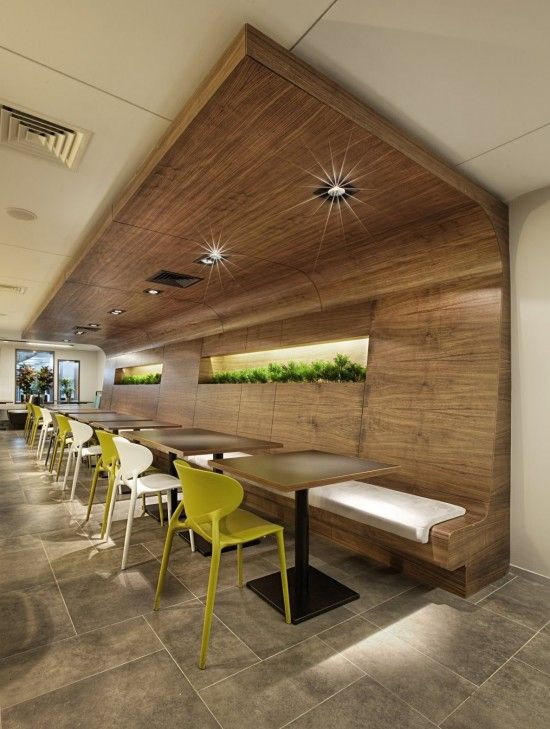 cafe seating : internal timber, bench seating, touch of yellow, backlit plants