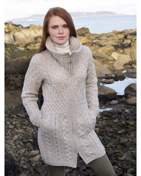 ARAN STYLE IRISH KNITTED DOUBLE COLLAR COAT. Made from 100% Merino Wool. Exceptionally beautiful coat, knitted using exclusively 100% natural Merino Wool, blending quality and strong Irish tradtion with the latest designs. This coat has a very unique zipper with the Celtic Knot symbol. The garment is knitted using truly authentic traditional Aran patterns.  'Fisherman's stitch (cable)', 'Diamond', and 'Moss' are some of the stitches used. Colours Available: Parsnip, Charcoal & Wine .