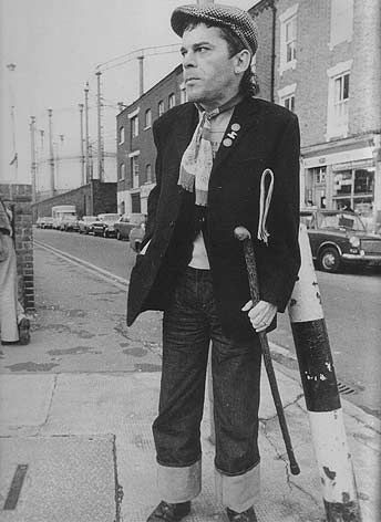 Ian Dury. Afflicted with polio as a child. Wrote the song, Sex  Drugs  Rock  Roll. Had bit parts in films incl. Peter Greenaway's The Cook, the Thief, His Wife  Her Lover, as well as Roman Polanski's Pirates.