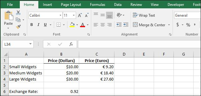 Excel spreadsheet - How to change the currency symbol on certain cells, without affecting other cells