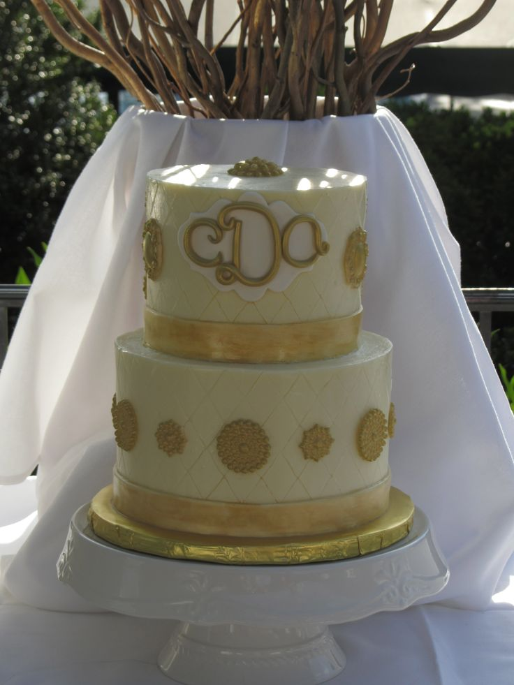 Great Gatsby inspired cake with sugar gold brooches and monogramed for a sweet 16 birthday.