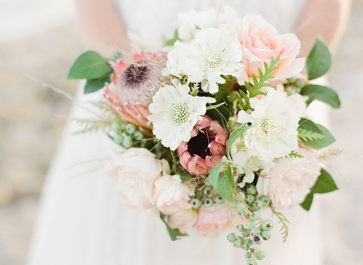 Beachy pink bouquet filled with proteas, roses, and greenery | Twig & Twine #pink #protea #beachy