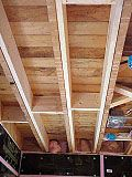 Sistered floor joists increase structural strength and stiffness.