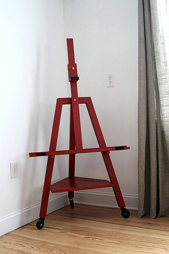 A beautiful minimalistic TV easel. Made out of solid hard wood. Annie Sloan Emperors Silk Chalk paint finished with Dark soft wax. Also available in any color Annie Sloan Paint offers:  https://www.anniesloan.com/annie-sloan-products/paints/chalk-paint.html  The easel is slightly tilted backwards about 10º for better stability and aesthetic look. Fits TV sets up to 55. Footprint: 30 width, 24 depth, 32 ledger width, 21 from the floor to the ledger, 10 from the floor t...