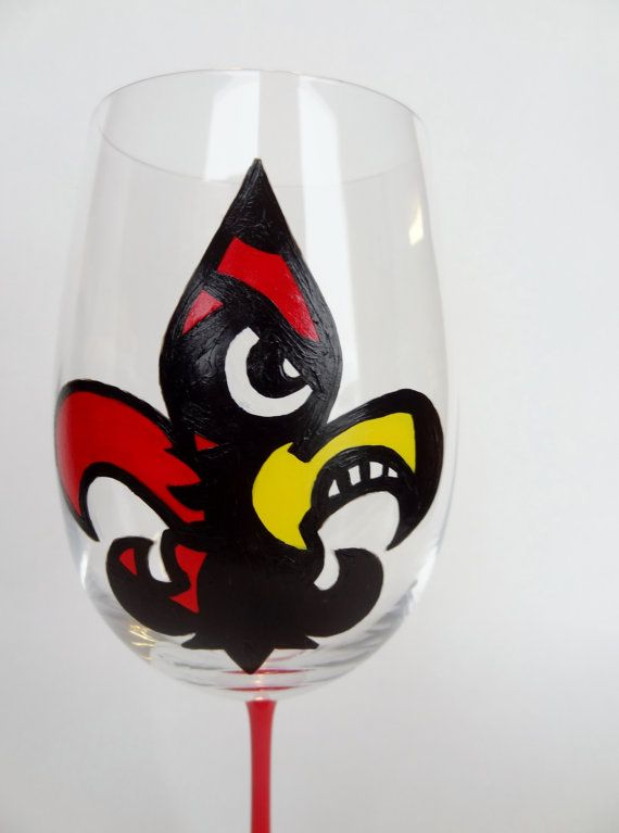This listing is for ONE Louisville Cardinal Fleur de Lis wine glass (please see below for details about ordering multiple glasses, or about seeing this design on another type of glass).  For this glass I have designed and hand painted a Fleur de Lis with the University of Louisville Cardinal Head inside.  This glass is 9.25 inches tall and hold 24 oz of your favorite beverage.  #gocards #wineglass #custom