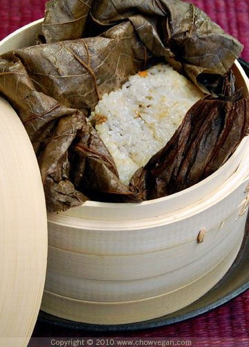 Sticky Rice in Lotus Leaf by chow vegan. To this recipe, cook sticky rice in mushroom/good veggie broth, chestnuts, toasted pine nuts, sauteed leeks and shallots.