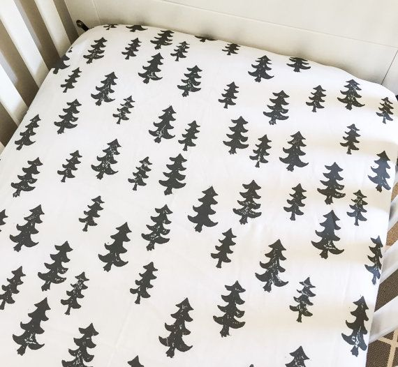 This listing is for a black trees fitted sheet. This fitted sheet measures 28in X 52in and fits a standard size crib or toddler mattress. This sheet is made of 100% cotton. Made in a pet free and smoke free environment. This sheet will ship within 2-3 weeks after purchase