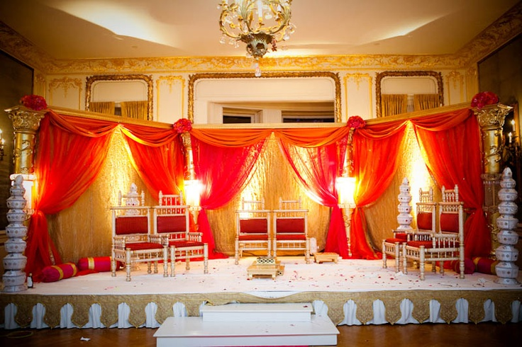 Mandap shape and colored curtains.