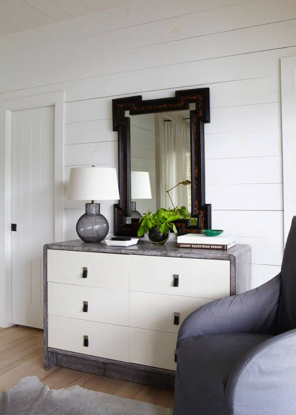 Rustic modern lakehouse with neutral colors // grey dresser // white planked walls