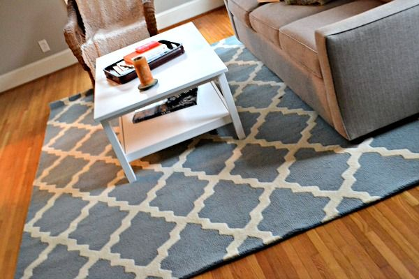 White Coffee Table Grey Couch Blue Patterned Rug