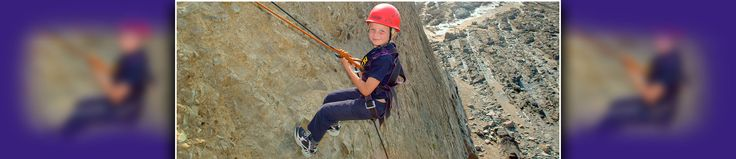 Abseiling on a School Activity Week at Outdoor Adventure Centre in Cornwall, UK