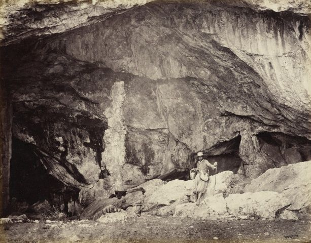 Entrance to the Grotto of Antiparos  16 May 1862.  Francis Bedford (1815-94). The Prince of Wales described his visit: 'A ride of 45 minutes brought us to the entrance of a large grotto or cave which is 60 fathoms in depth. We descended it by means of rope and rope ladders, and it was by no means an easy job. … There are some very fine stalactites in the cave.' Acquired by the Prince of Wales, 1862.