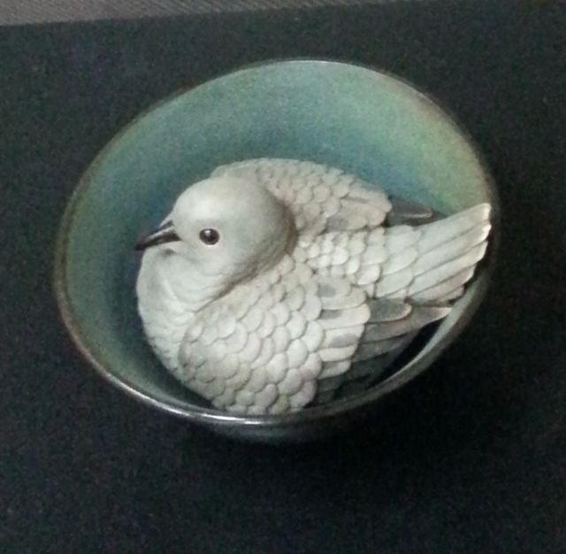 Carved wooden dove in ceramic bowl, work in progress by Abdul-Rahman Abdullah