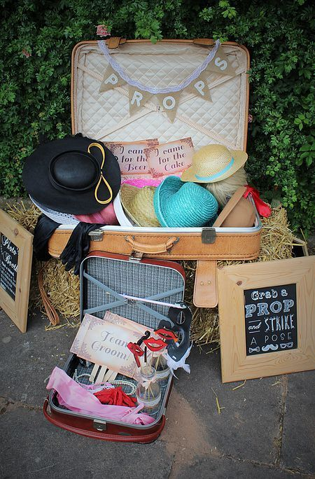 Here's a fun photo booth idea! Some thrift shop suitcases with assorted hats and scarves!