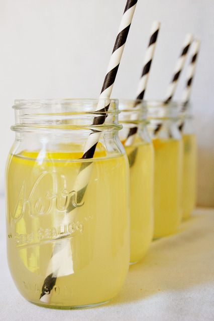 "Black and White paper straws and lemonade to stick with the ""bee"""