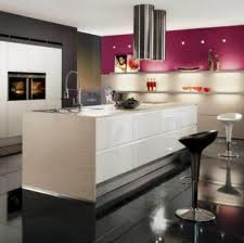 Great use of cream gloss and a bright accent colour. http://www.exdisplaykitchen.co.uk/Main%2520Pic.jpg