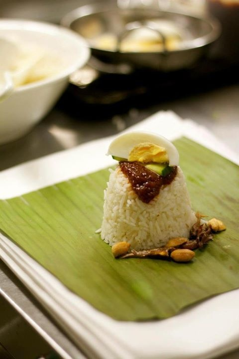 Nasi Lemak Bungkus (traditional coconut rice, sambal and condiments in a banana leaf wrap.