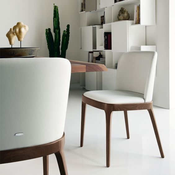 The Magda is an amazing chair the will compliment any wooden topped table or glass top/wooden base combination. This stunning addition to Cattelan's chair collection was designed by Studio Kronos and features a low profiled wooden frame and legs. The Magda's slim profile makes it perfect for small spaces. The seat and slightly rounded back are upholstered for optimal comfort. The base and legs can be finished in walnut, natural oak, wenge, or oak stained black or white.