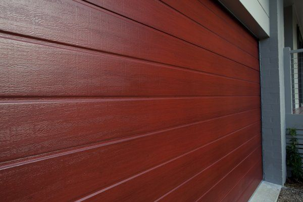 "DecoWood ""Jarrah"" Garage Door http://www.decorativeimaging.com.au/index.php?option=com_rsgallery2&page=inline&id=94&Itemid=53 #garagedoor #design #architecture #redtimber"