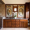 Enhance an exotic bath with a luxurious vanity in earthy tones and textures. Mocha-glazed cherry cabinets feature doors with beaded detail for a transitional look