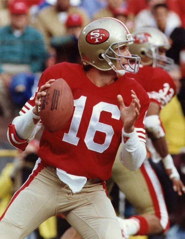 Joe Montana with Roger Craig in the background