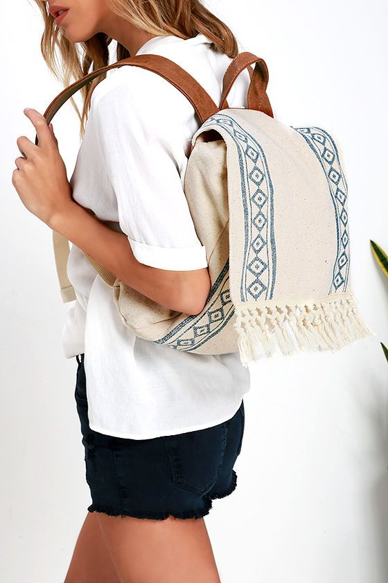 "That festival you've got coming up would be a perfect place to showcase the Billabong Moonglow Beige Print Backpack! Tan vegan leather straps support a woven beige backpack with a navy blue diamond print. Lift the fringe-accented flap from magnetic closures to use the fabric lined interior with a zipper pocket and drawstring top. Shoulder straps measure 30"""" at longest adjustment. Metal logo tag at front. #fashion #style #streetstyles #popsugar #wachabuy #apparel"