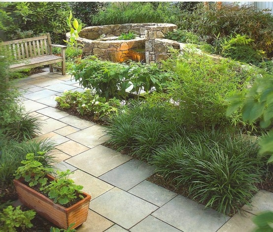 bluestone path, stone walls and plants