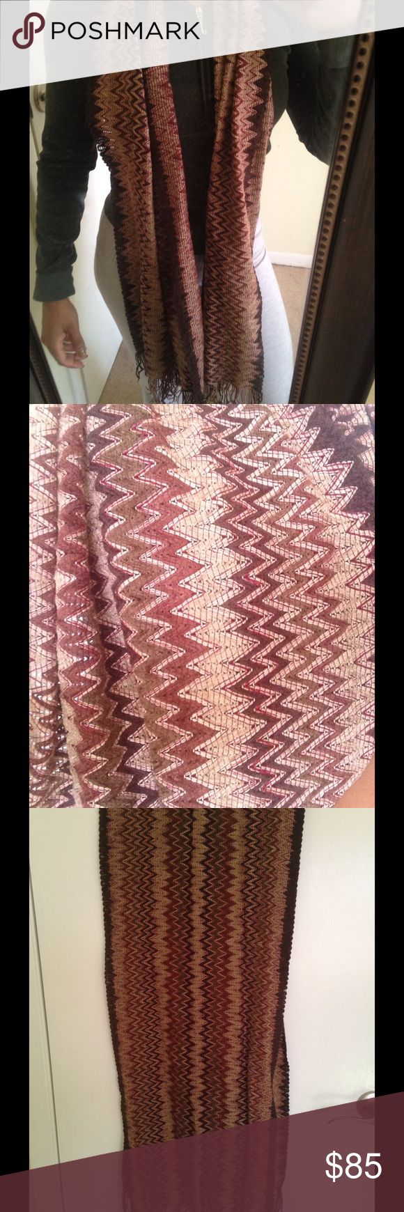 Authentic Missoni Scarf Authentic Missoni scarf bought from Newman Marcus last call. The colors on the scarf are various Browns with a pop of a deep pink and green. This scarf pairs well with any of the colors listed above. This scarf is the perfect winter accessory. I paid 149 for this scarf and have only used it once with my outerwear for an event. I am open to any reasonable offers. Missoni Accessories Scarves & Wraps