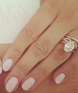 Love the idea of a simple solitair oval engagement ring with stack able wedding bands... Top 3 for sure in white gold