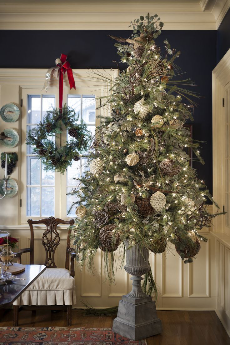 Nell Hills.  I love how the tree looks in the tall urn.  #Christmas #Open_House #decor