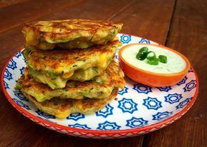 Sweetcorn & Zucchini Fritters  Gluten Free, Nut Free, Dairy Free (option)    Ingredients:  2 corn cobs, husks and silk removed 4 (about 520g) zucchini, ends trimmed, coarsely grated 3 spring onions, chopped 2 cloves garlic, minced (optional – I find they need the garlic f