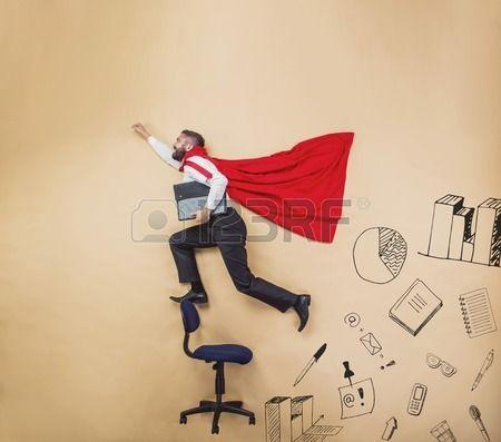 Manager with coat of superman Superhero in studio  Stock Photo