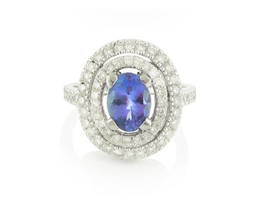 An 18ct White Gold Tanzanite and Diamond Double Halo Ring