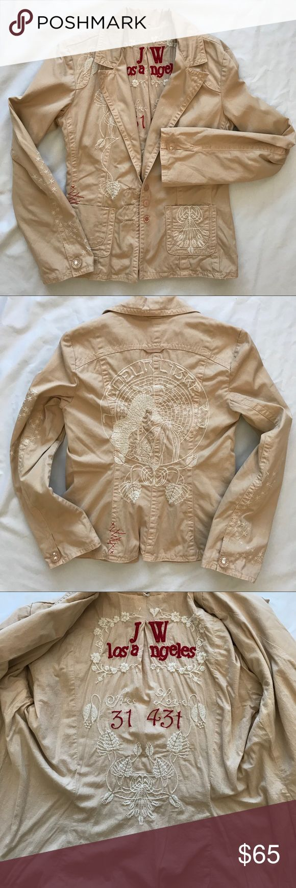 """Johnny Was Tan Embroidered Woman Blazer Small This embroidered blazer by Johnny Was is in overall good used condition.  Size small.  Tan in color with cream embroidery.  Embroidery is in good shape, but there are a few snags, most prominently, on the back, as shown.  Also embroidered on the inside with the signature red JWLA,  """"Free Love."""" Beautiful woman on the back.  Mismatched (intentionally) buttons.  Outside 100 cotton, lining 100 polyester.  Bust flat 18, length 23. Johnny Was Jackets…"""