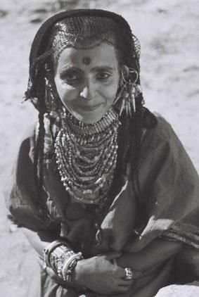 A Habbani Jewish woman from the Habban region in Yemen, wearing traditional silver jewelry.