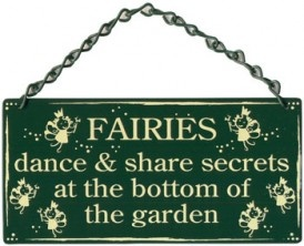 Fairies Dance & Share Secrets At The Bottom of The Garden.