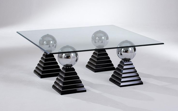 The modern coffee table Marrakesch features pyramid-shaped legs, which can be made from black, white, or clear arcylic.