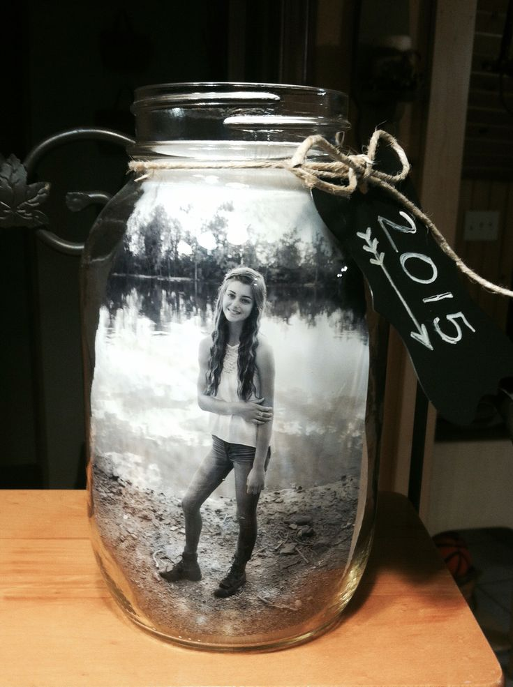 Mason jar centerpiece for graduation! I put 2 pictures in the jar so you could see a pic from either side. I added some decorative paper and star confetti, and topped them of with some tin lids I found at my local craft store. I tied some helium filled balloons in her school colors to the tops of the jars. They were easy and made really cute centerpieces!