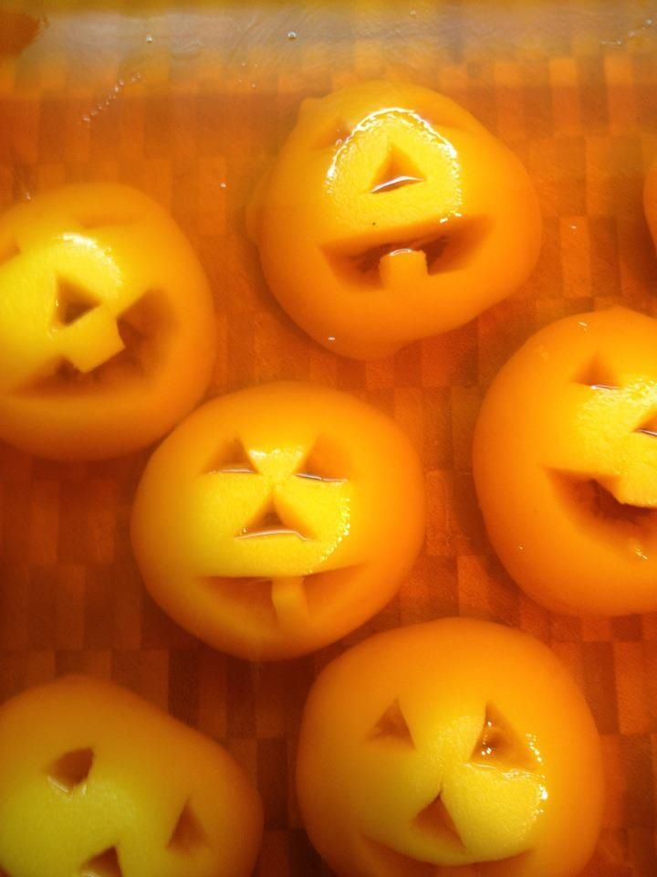 Easiest Halloween desert. Great for class parties at school.  You take half peaches in the can and carve the faces of pumpkins in them, then put them in a shallow container.  Then cover them with orange Jello.  The kids love them!